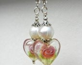 Pearls and glass heart earrings.