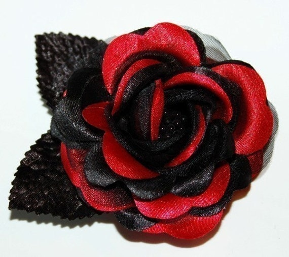 Put it in your hair for extra flair. Alligator clasp hair clip with black and grey rose design. 4 1/4