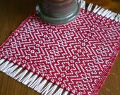 Handwoven zigzag coasters / mug mats in red. Set of 4 handmade by Nutfield Weaver.