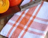 Handwoven kitchen towel / pumpkin orange & white farmhouse plaid by Nutfield Weaver.