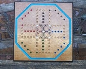 Aggravation game board with celtic design Sign d by craftsman