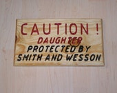 Daughter protected by smith and wesson simple wood sign with a message