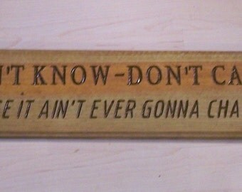 Don't Know Don't Care engraved wood sign