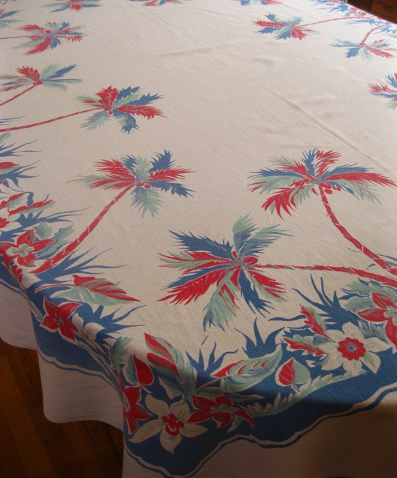 Red white and blue vintage 1940s tropical tablecloth with palm trees and orange blossoms