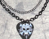 Double chain necklace with skull guitar pick pendent