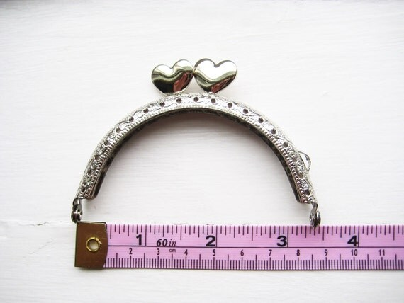 8.5cm/3.3 inch Silver purse frame with heart shaped snap head, sew holes, and single loop