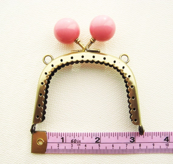 8cm/3 inch Antique Brass purse frame with large baby pink kiss lock head, sew holes, and double loops