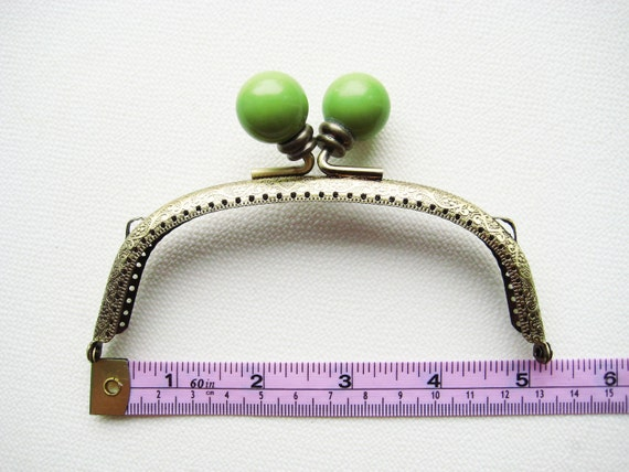 13cm/5 inch Antique Brass purse frame with large acrylic wasabi green head, sew holes, and double loops