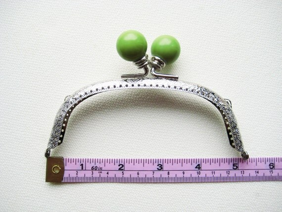 13cm/5 inch Silver purse frame with large wasabi green acrylic head, sew holes, and double loops