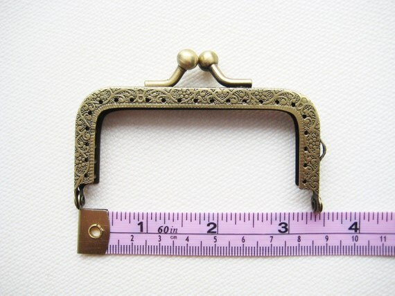 8.5 cm/3.375 inch antique brass purse frame kiss lock clasp snap with antique embossing regular snap head sewing sew in on holes