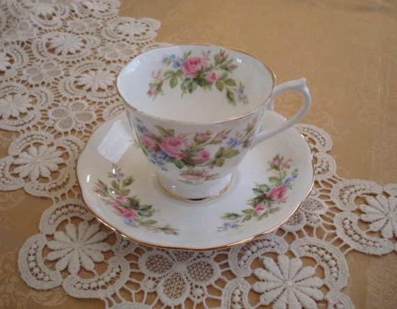 MOVING SALE....Tea Time Necessity....Pretty Vintage Royal Albert Footed Teacup and Saucer...Moss Rose