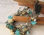 Multi Strand Macrame Bracelet with Teal and Turquoise Beads on Brown