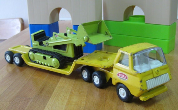 Vintage Tonka Green Bulldozer working with rubber treads