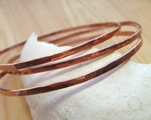 Hammered Textured Thick Shiny Copper Bangles by LauraMartin