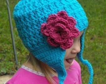 Hand Crochet Toddler or Children's Hat in Turquoise with a Pink Flower