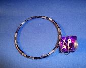 purple dice bracelet