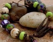 BIRD IN FLIGHT - Antiqued Brass Vintaj Bird, Handmade Lampwork and Ceramic Beads, Antiqued Brass Components