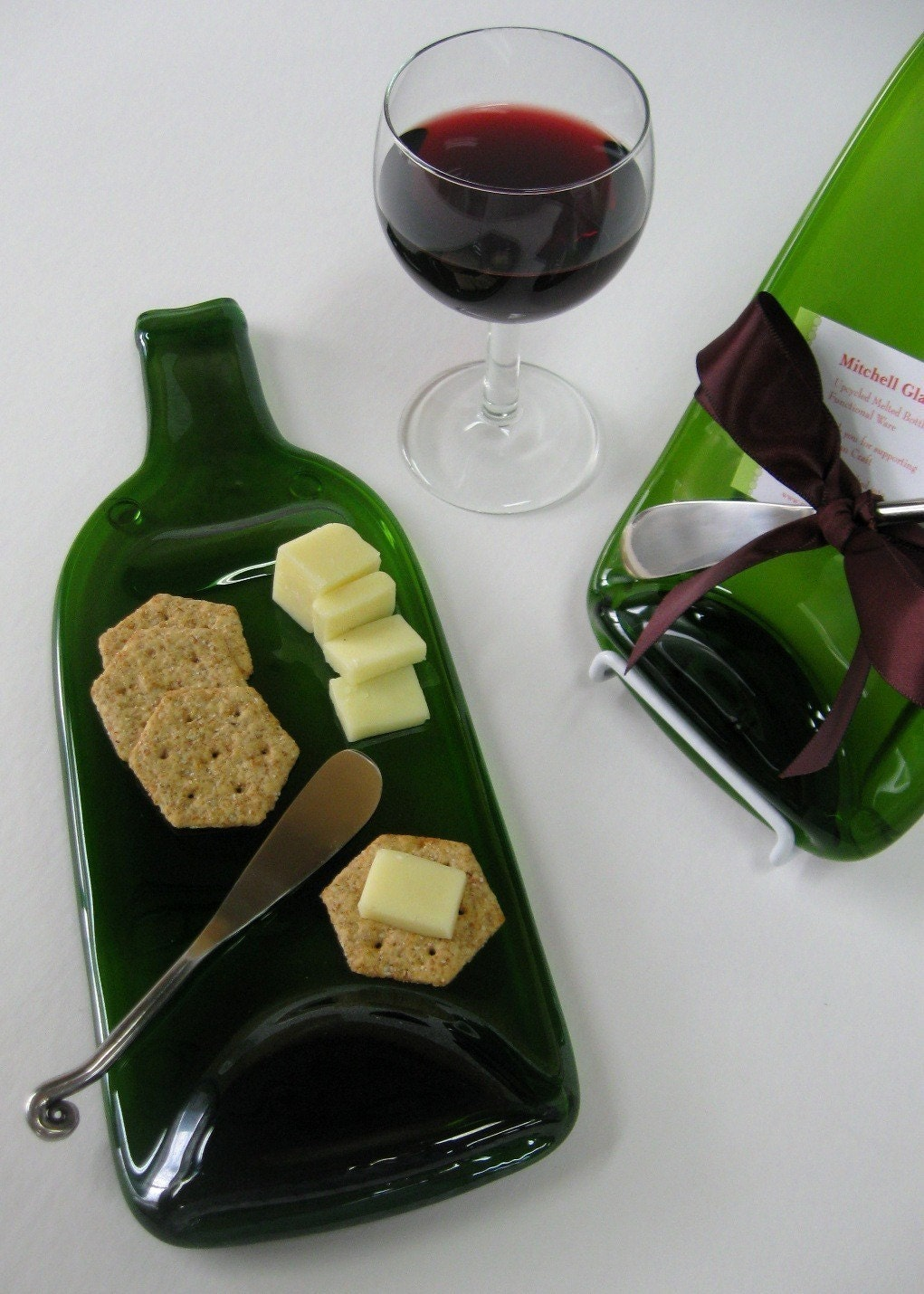 melted wine bottle cheese plate with plum by