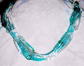 emerald and white bead weaving and strings necklace