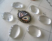 NEW...20 Earring Size Oval Glass Cabochon. Great for pendants or earrings. Size 18x13mm