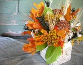 Fall dried flower centerpiece in birch bark basket