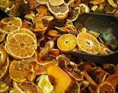Homemade orange spice potpourri with bottle of refresher oil.