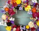 Handmade rainbow color spring dried flower garden wreath. All natural.
