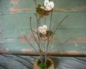 Twig centerpieces with bird's nest and eggs with engraved birch hearts .  Personalized for your wedding or shower.