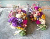 All Natural dried flower corsage in a potpourri of colors. Wrist or pin on. Featuring Lavender. For your garden wedding.