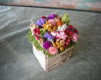 Cute handmade garden spring dried flower centerpiece in birch bark box. All natural.