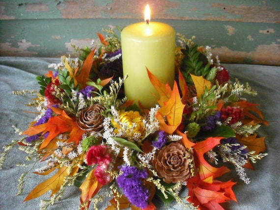 Dried flower candle ring or wreath centerpiece for your fall autumn nature themed wedding.