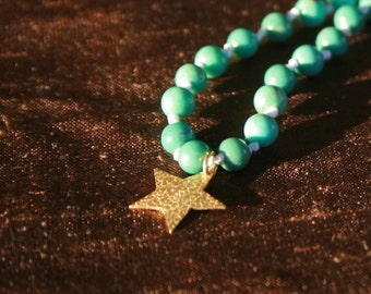 18k gold star and turquoise necklace