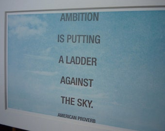 """Proverb """"Ambition is putting a ladder against the sky"""" quotation mini matted print"""