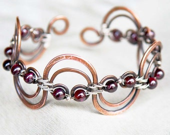 Artisan Copper and Sterling Silver Openwork Wave Bracelet with Garnet