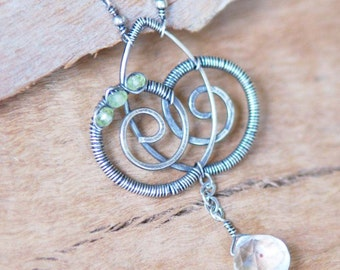 Artisan Sterling Silver Necklace with Rock Crystal and Peridot - Intersecting Spirals