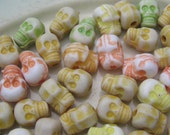 Destash lot of 60 skull resin beads 7mm yellow orange green