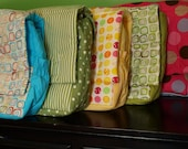 Shower that new mom with a soft colorful diaper bag.