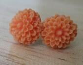 chrysanthemum post earrings in sherbet orange.