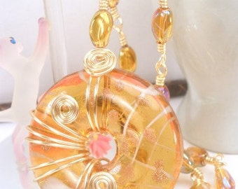 Golden yellow glass donut pendant wire linked handmade necklace