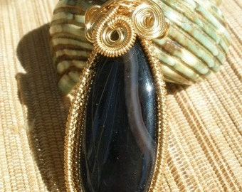 Black banded agate teardrop wire wrapped pendant with large bail