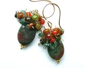Arctic Summer -- Goldfilled earwires with clusters of tourmaline and carnelian topping a bloodstone oval