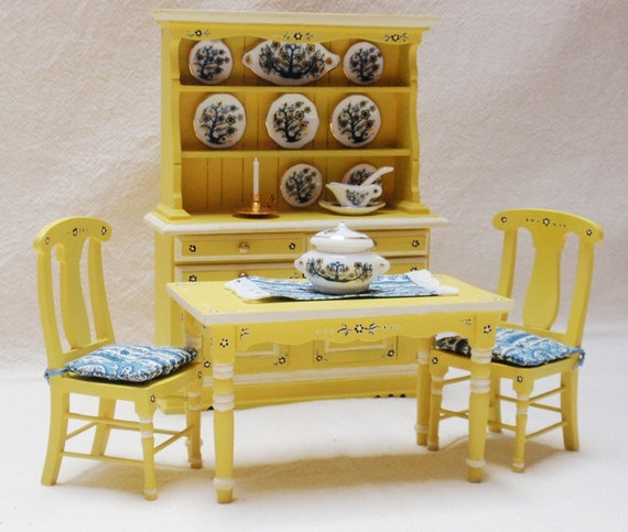 Dollhouse miniature cupboard, table and chairs in yellow with tiny flowers in ultramarine blue and white