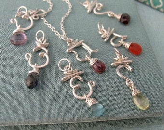 Set of 7 Chakra Pendants with semi-precious stones
