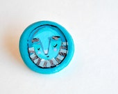 blue brooch man illustrated jewelry