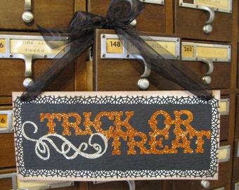 Wall Sign, Trick or Treat Halloween Black and Orange Glitter Hanging Sing with Black Ribbon