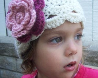 Infant size flower hat cream with dual pink flower