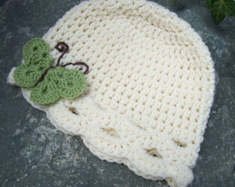 Child size butterfly hat cream with green apple
