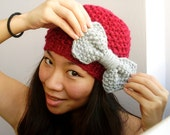 Red winter toque with bow, warm winter hat with grey bow