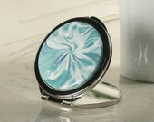 Compact with Polymer Clay Cover featuring Teal Burst Design