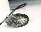 Polymer Clay Pendant featuring Black and Gold Stamped Sun Design